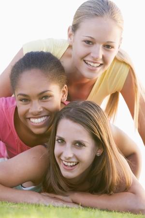 4446900 - teenage girls having fun outdoors